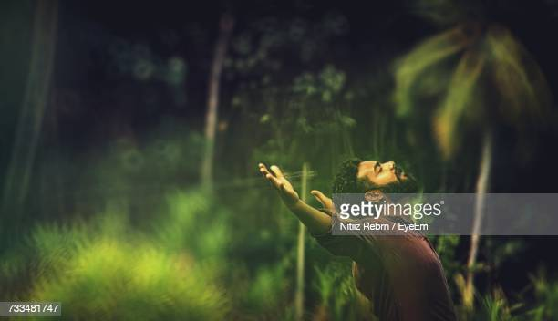man in forest - thiruvananthapuram stock photos and pictures