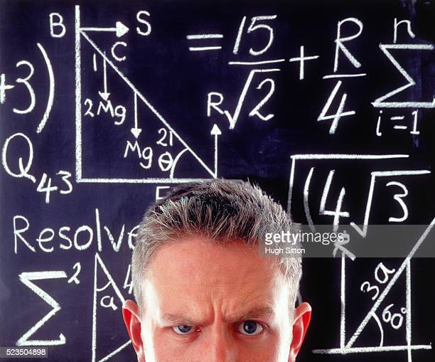 man in front of a board with numbers - hugh sitton stock-fotos und bilder