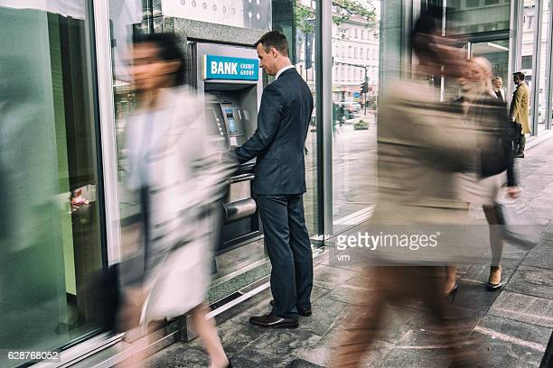 Man in front of an ATM machine