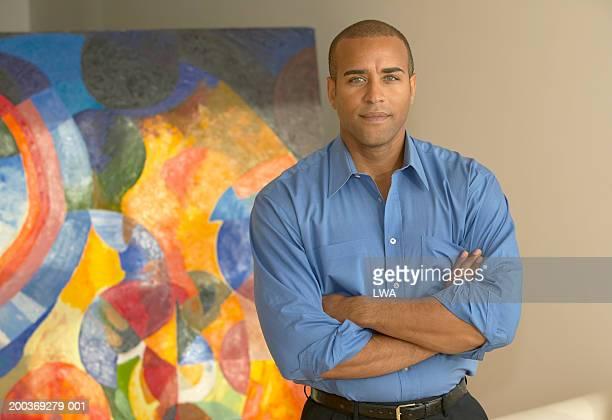 Man in front of artwork, portrait