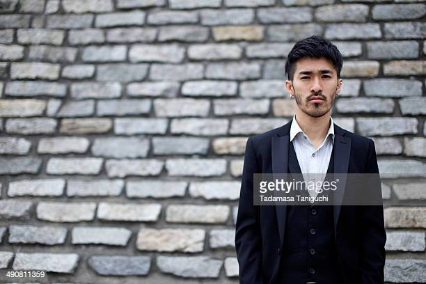 man in front of brick - goatee stock pictures, royalty-free photos & images