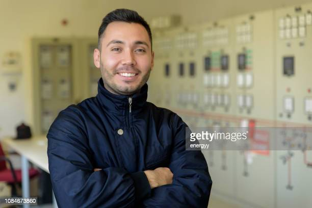 man in front of control panel - nuclear power station stock pictures, royalty-free photos & images