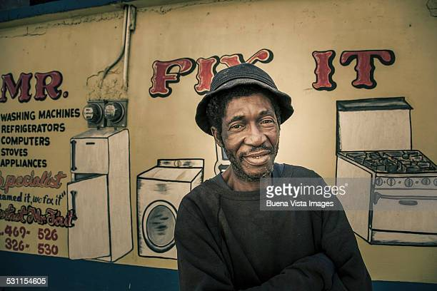 man in front of his repair shop - kingston jamaica stock pictures, royalty-free photos & images