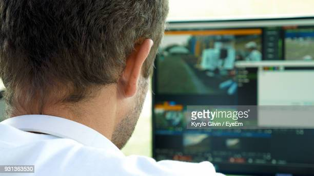 Man In Front Of Monitor Screen