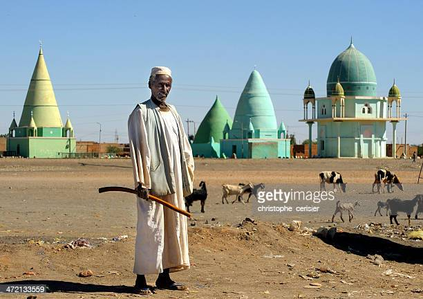 man in front of muslim mausoleums, sudan - khartoum stock pictures, royalty-free photos & images