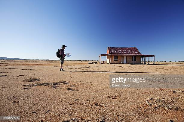 man in front of outback shed - abandoned stock pictures, royalty-free photos & images