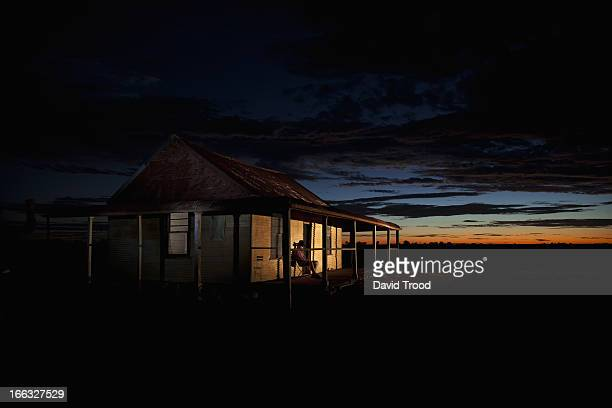 man in front of outback shed - farmhouse stock pictures, royalty-free photos & images
