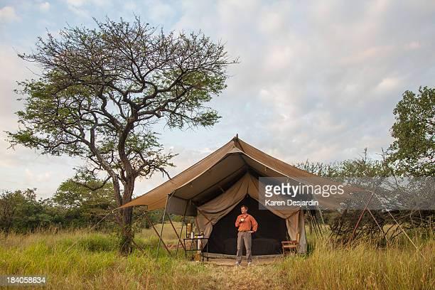 Man in front of safari tent, Serengeti