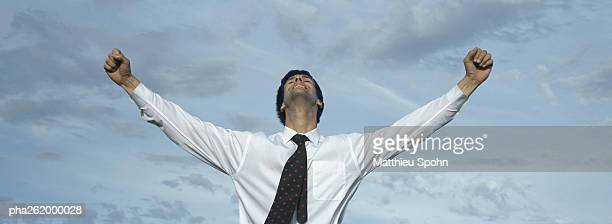 man in front of sky with arms outstreched, waist up, front view - shirt and tie stock pictures, royalty-free photos & images
