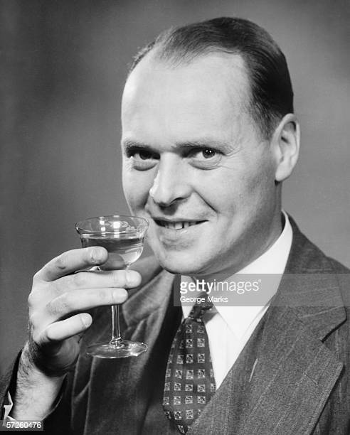 man in full suit raising  glass of wine,  (b&w), close-up, portrait - striped suit stock pictures, royalty-free photos & images