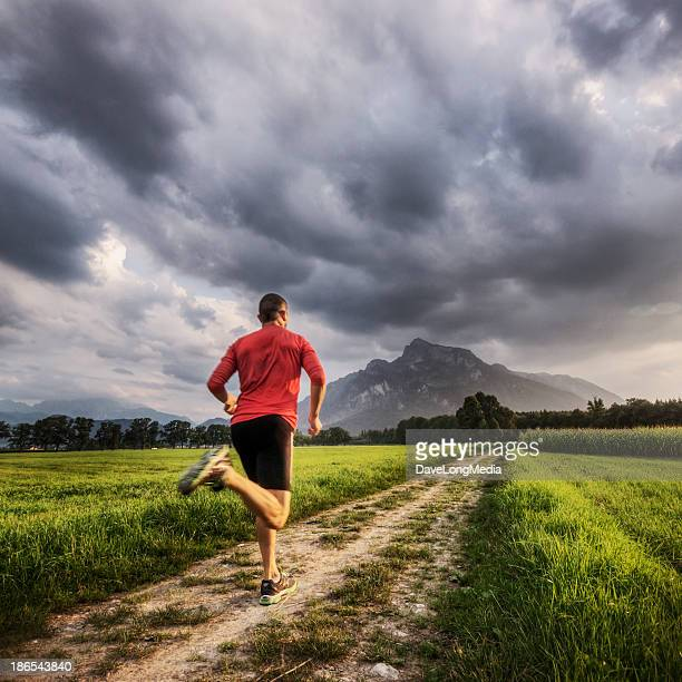 Man in fun clothes jogging in the Alps