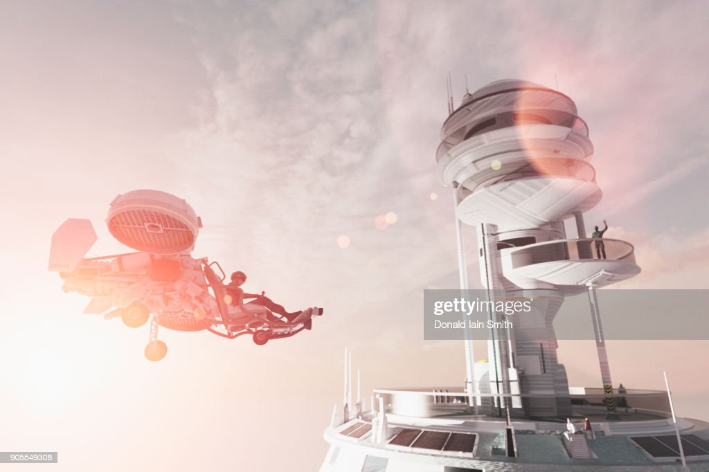 Man in futuristic tower waving to flying vehicle : Stock Photo