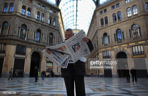 Man in Galeria Umberto reads a newspaper declaring Italy's new prime minister on November 14, 2011 in Naples, Italy. Italian Prime Minster Mario...