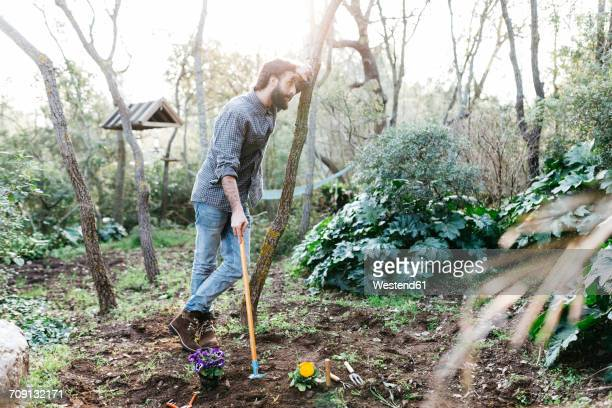 Man in garden having a break from gardening