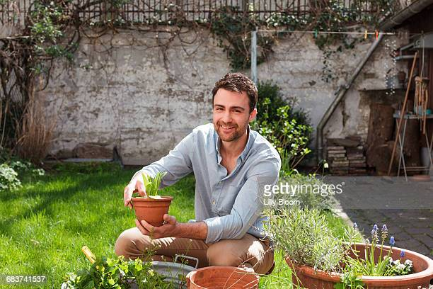 man in garden tending to plants - green fingers stock pictures, royalty-free photos & images