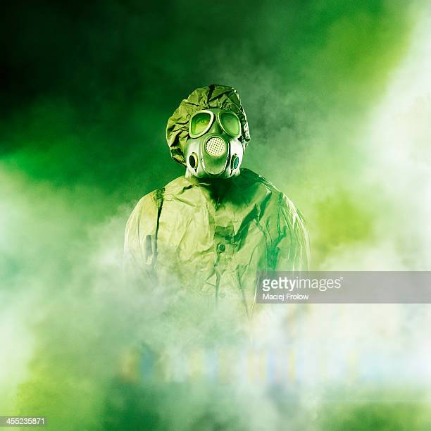Man in gas mask in dense smoke