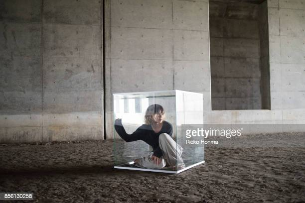Man in glass cube