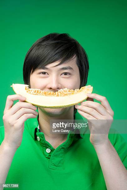 Man in green with melon