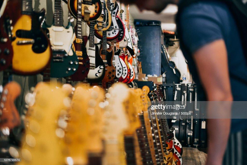 Man in Guitar Shop : Stock Photo