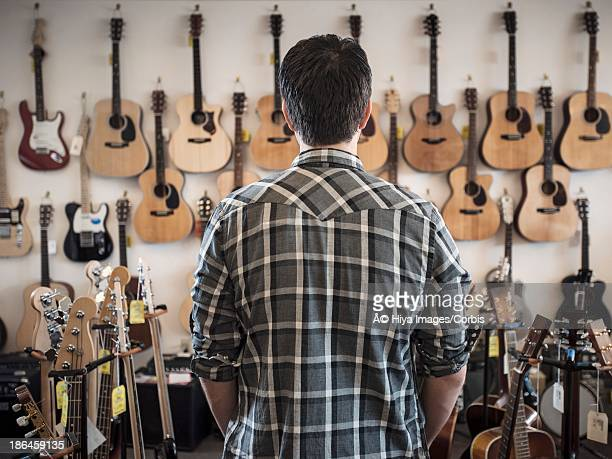 Man in guitar shop