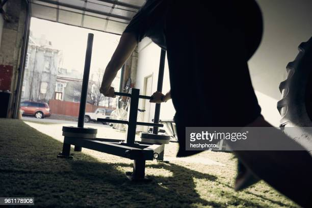 man in gym using exercise equipment - heshphoto stock pictures, royalty-free photos & images