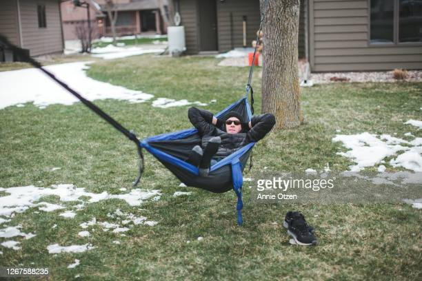 man in hammock - sioux falls stock pictures, royalty-free photos & images