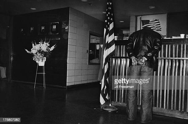 Man in handcuffs waits to be questioned at the NYPD Midtown South Precinct, New York City, 1979. This particular precinct suffered a plague of...