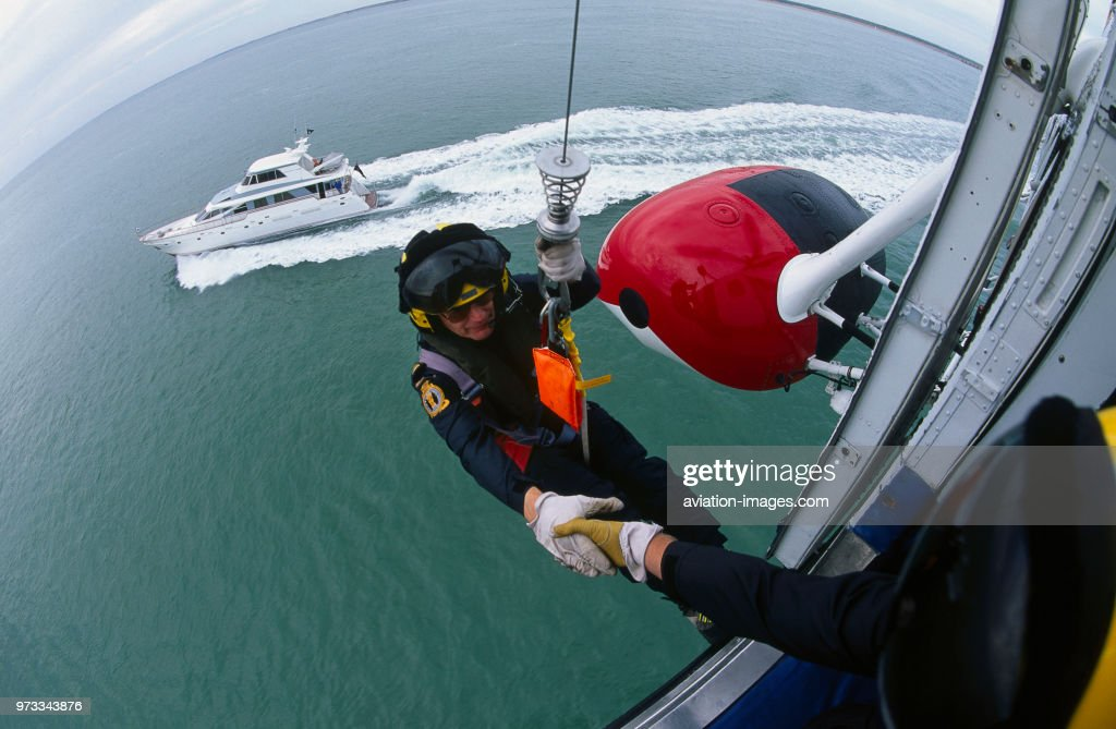 man in harness on a cable from a winch on a hm coastguard sikorsky rh gettyimages ca winch wiring harness dog winch harness