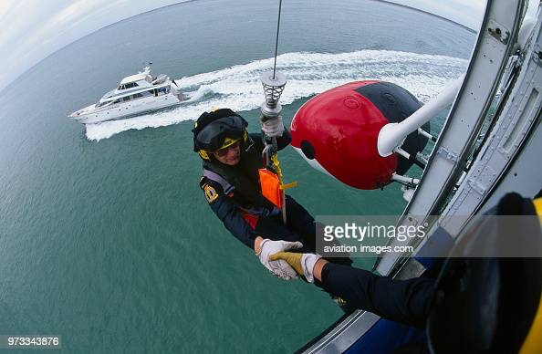 man in harness on a cable from a winch on a HM Coastguard Sikorsky... News  Photo - Getty Images   Winch Harness      Getty Images