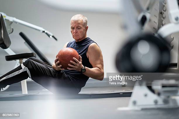 man in health club exercising with ball - medicine ball stock pictures, royalty-free photos & images