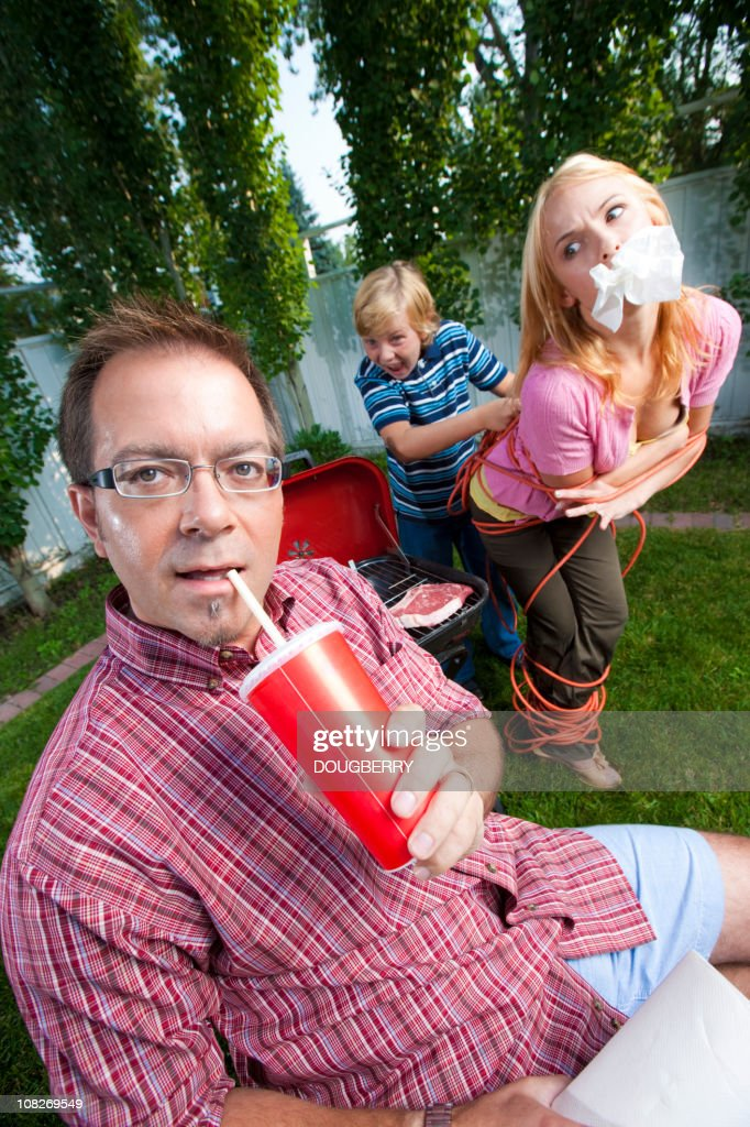 Man in his backyard : Stock Photo