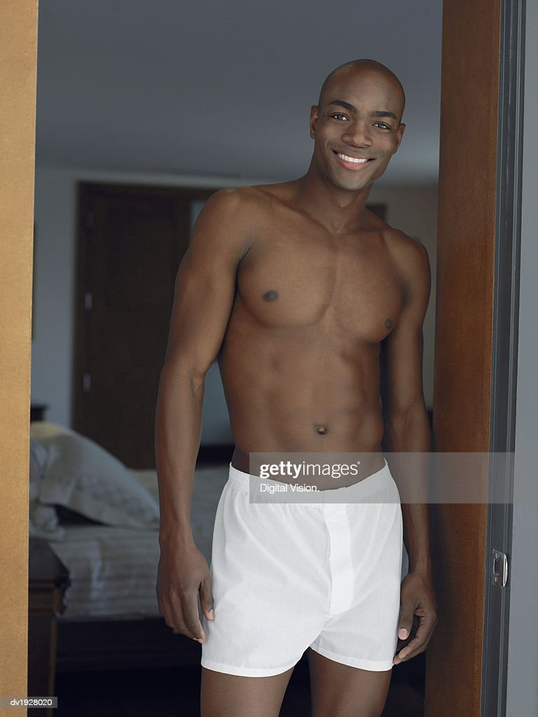 Man in His Boxer Shorts Standing in Bedroom Door : Stock Photo