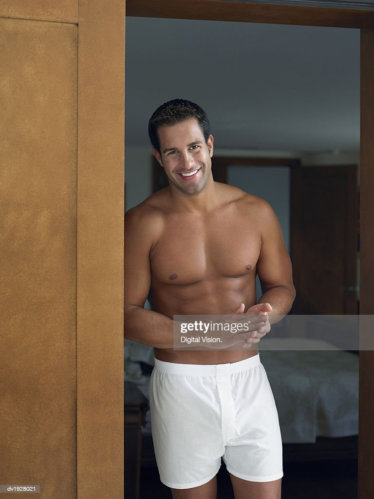 Man in His Boxer Shorts Standing in Bedroom Door : Stock Photo