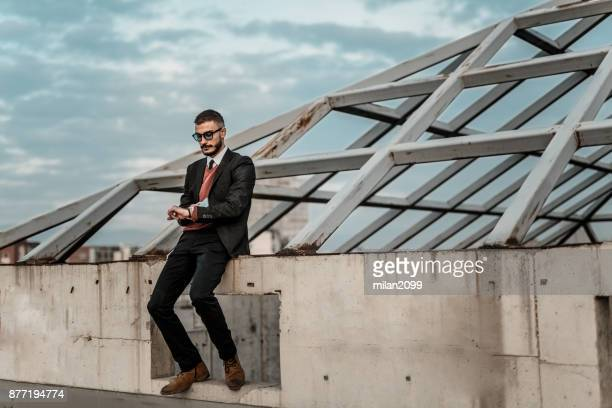 Man in his suit with sunglassess