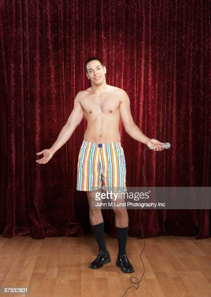 man in his underwear on stage - boxershort stock pictures, royalty-free photos & images