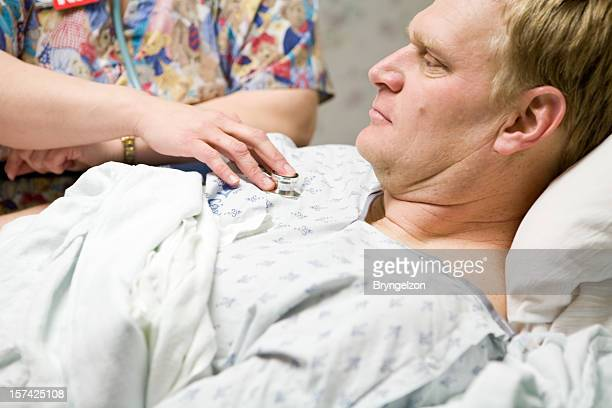 man in hospital bed - heart disease stock pictures, royalty-free photos & images