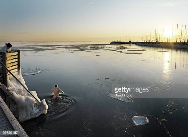 Man in icy sea.