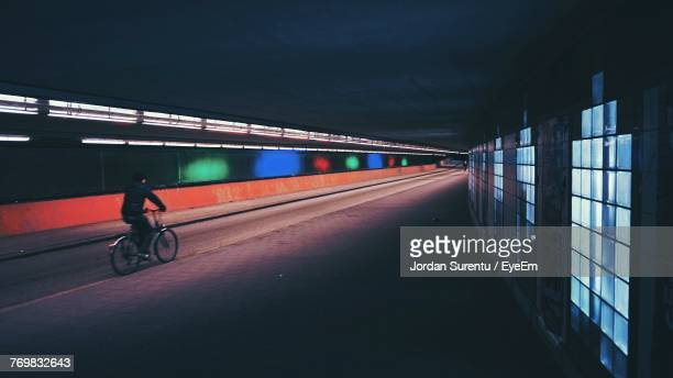 man in illuminated tunnel - utrecht stockfoto's en -beelden
