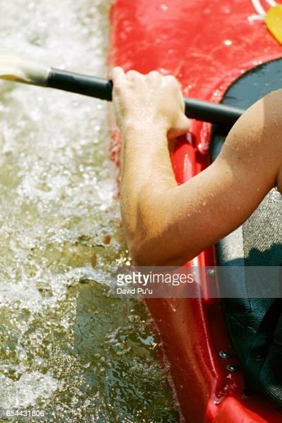 Man in Kayak Holding Oar