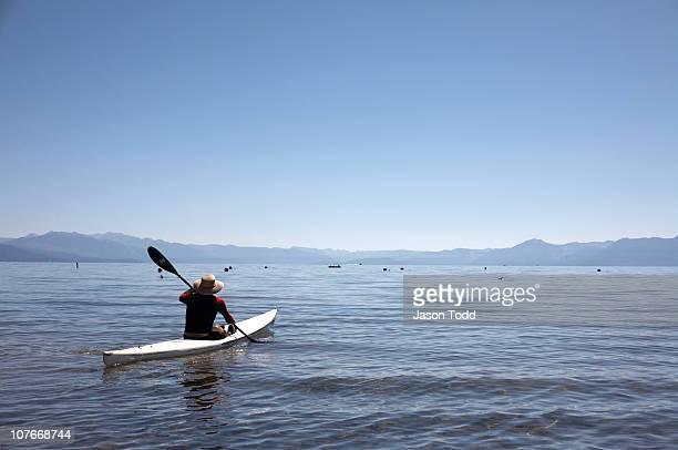 man in kayak on lake