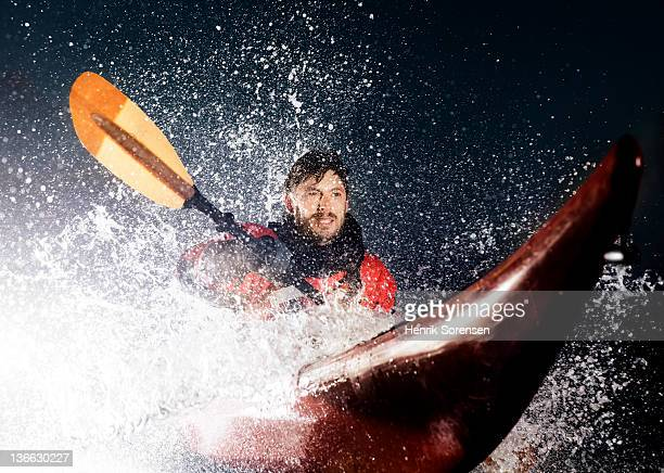 Man in Kayak sprayed by wave