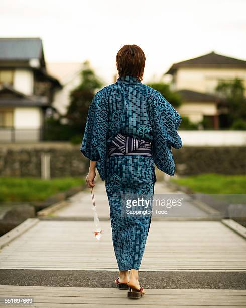 Man In Kimono Walking With Goldfish