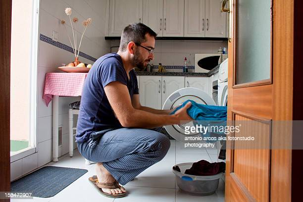 man in kitchen - daily bucket stock pictures, royalty-free photos & images