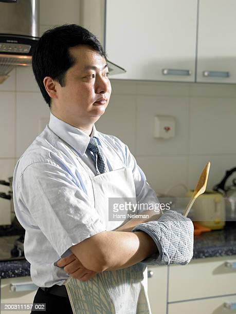 man in kitchen wearing apron - hans neleman ストックフォトと画像