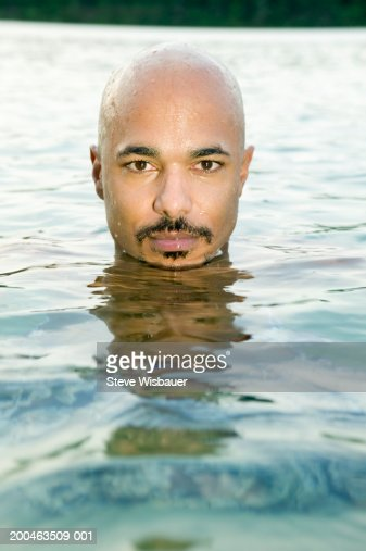 Man In Lake Head Above Water Stock Photo