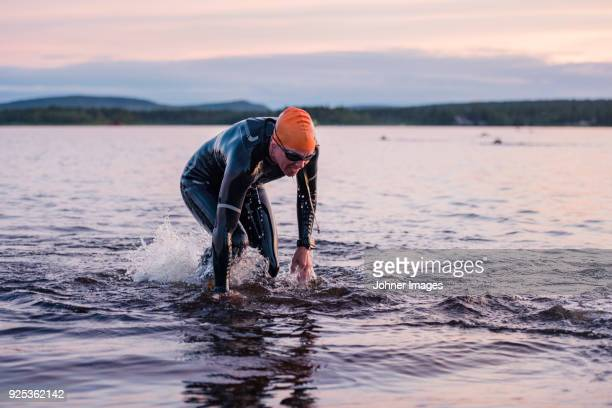 man in lake - triathlon stock pictures, royalty-free photos & images