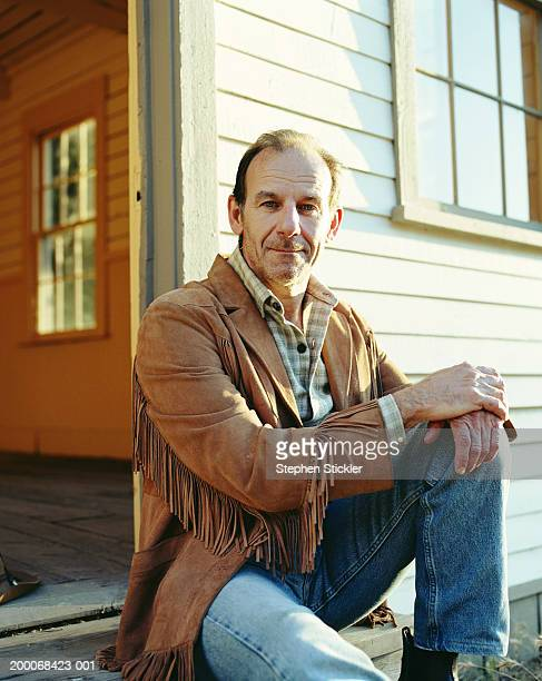 man in leather jacket sitting on steps, portrait - fringing stock pictures, royalty-free photos & images