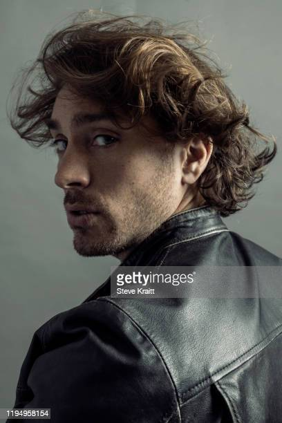 man in leather jacket turning around surprised, grey background - looking over shoulder stock pictures, royalty-free photos & images