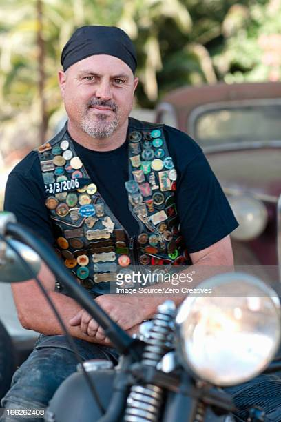 Man in leather vest on motorcycle