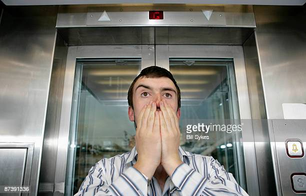 man in lift - claustrophobia stock photos and pictures